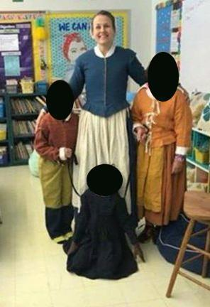 School officials in Bridgewater apologized Thursday after a classroom photo that appeared to show two white third-graders holding a black child by leashes caused outrage. Faces have been obscured to protect children's identities.